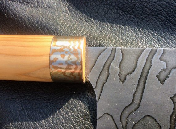 closeup of pattern on damascus steel blade