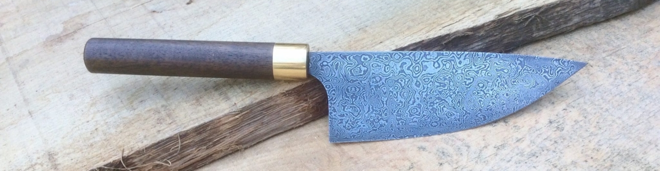 damascus steel knife with walnut handle and brass ferrule