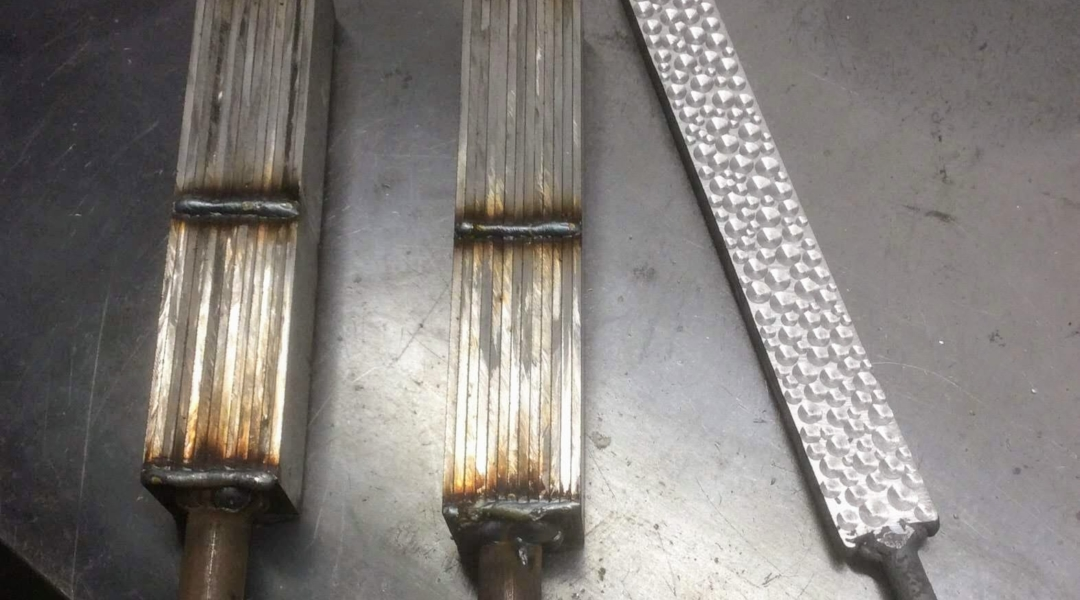 sandwiched layers of steel welded together to form a billet