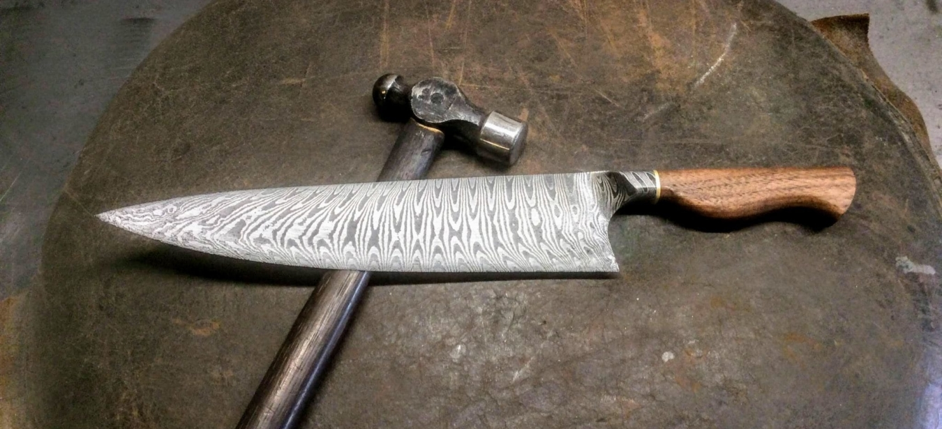 beautiful damascus steel chef's knife with shaped wooden handle