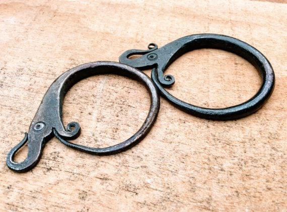 two forged steel 'World Serpant' keyrings